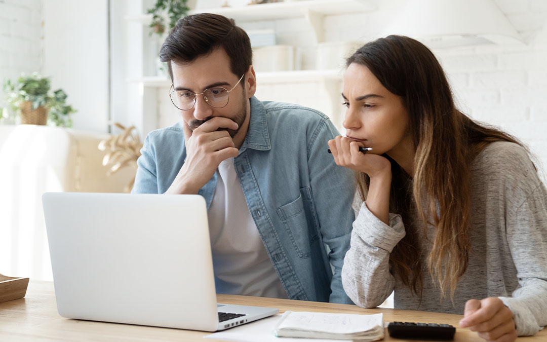 A man and woman on a laptop during tenant screening
